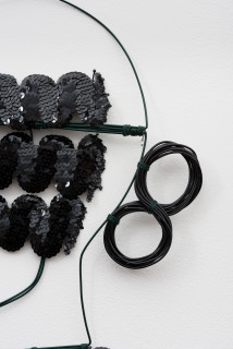Jacqueline Fraser A clustered portrait composed > (detail), 2003; from the series AN ELEGANT PORTRAIT REFINED IN ELEVEN STUDIOUS PARTS >; wire, sequin braid from Chelsea, N.Y; 85 x 35 cm; enquire