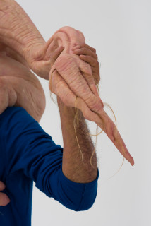 Patricia Piccinini Sapling (detail), 2020; silicone, fibreglass, hair, clothing; 201 x 94 x 46 cm; Edition of 3 + 1 AP; enquire