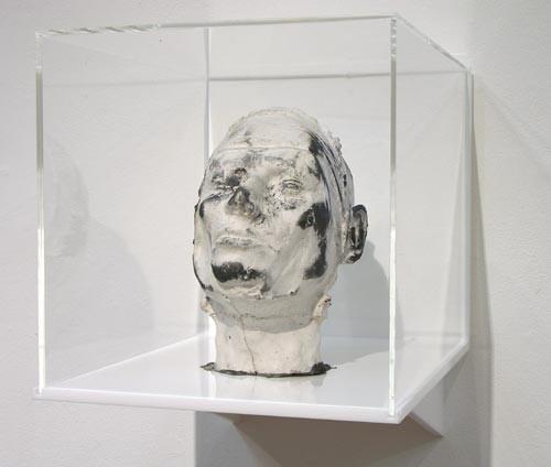 Julie Rrap Eraser Head 3, 2006; silicon rubber, silica flour and graphite mounted in Perspex box; sculpture: 21 x 15 x 25 cm; box: 30 x 30 x 40 cm; enquire