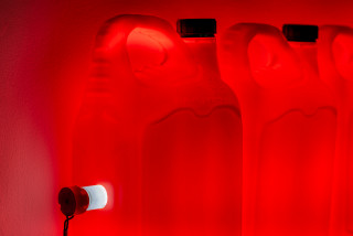 Bill Culbert Strait (Red) (detail), 2015; fluorescent light, plastic bottles; 32 x 120 x 12 cm; enquire