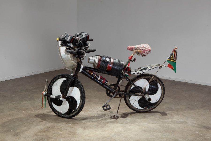 Newell Harry Reverse Missionary (Easy Rider), 2010; Exchanged Ngunese village bicycle, for artists Cannondale V900 mountain bike. Exchanged bicycles, Mp3 player/sound, single colour photograph documenting the transaction; enquire