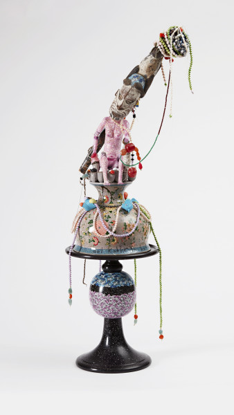 Del Kathryn Barton salad bowl #6, 2016; traditional Indian salad bowl, faceted gemstones, vintage My Little Pony, dyed pearls, wooden figurines, gumnuts, hemp twine, shells, acrylic paint, antique anodized cast aluminium side table, silver facetted beads, plastic beads; 190 x 50 x 50 cm; (with plinth & vitrine); enquire