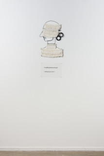 installation view; Jacqueline Fraser A muffled portrait prolonged >,, 2003; from the series AN ELEGANT PORTRAIT REFINED IN ELEVEN STUDIOUS PARTS >; wire, French braid from La Pigalle, Paris; 85 x 35 cm; enquire