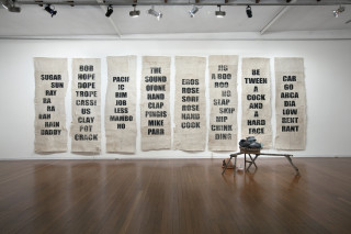 indicative installation view; Newell Harry Untitled (MILF/FILM/LAME/MALE), 2013; Tongan Ngatu (bark cloth), ink; 279 x 118 cm; Edition of 2 + 1 AP; enquire