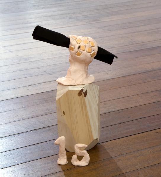 Mikala Dwyer 15, 2009; molding clay, wood, artist?s blood, tiles, felt; 30 x 11 x 11 cm; enquire