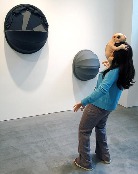 Patricia Piccinini The Embrace, 2005; silicone, fiberglass, leather, plywood, clothing, human hair lifesize; dimensions variable; Edition of 3 + AP 1; enquire