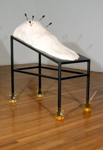 Ken Unsworth Between Life & Death, 1990; mild steel, paraffin wax, darts, glass jugs & water; 185 x 77 x 153 cm; enquire