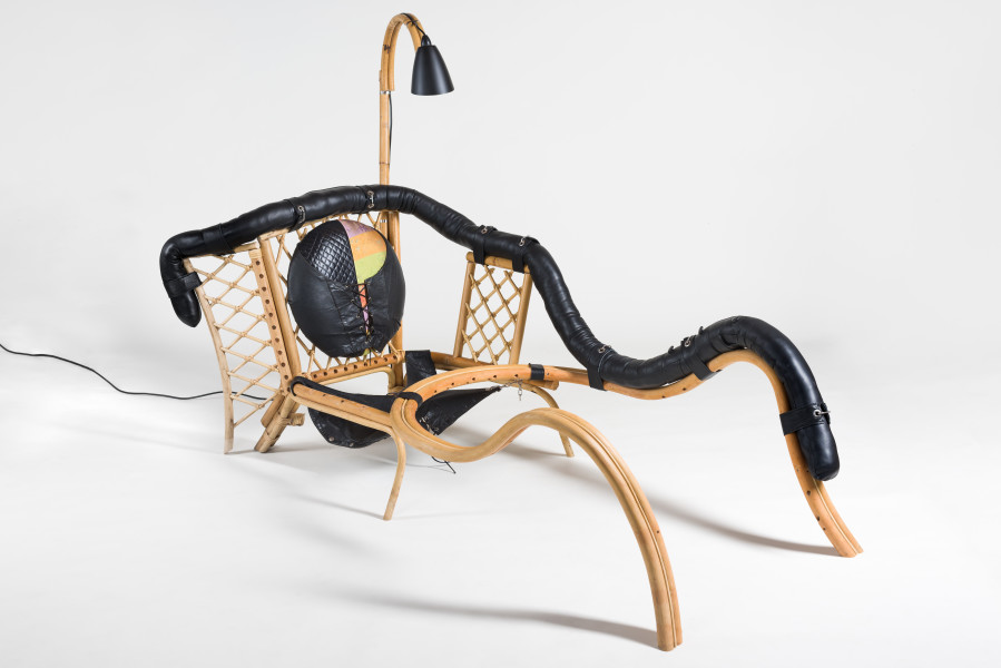 Sarah  Contos Recliner, 2019; repurposed cane and leather, fabric, poly-fibre, light fixtures, stainless hardware; 130 x 84 x 180 cm; enquire
