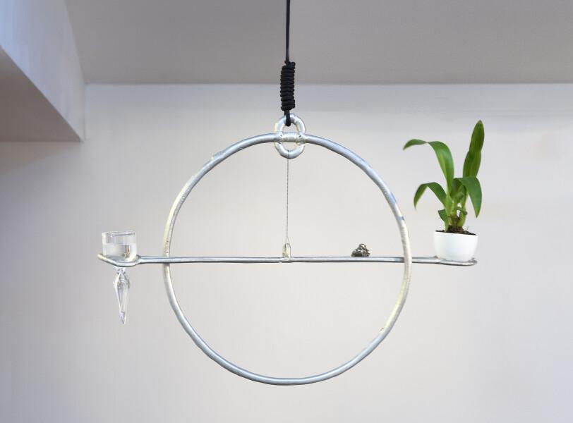 Caroline Rothwell Equilibrium, 2017; Britannia metal, orchid, glass, water, rope; 47 x 65 x 65 cm; enquire