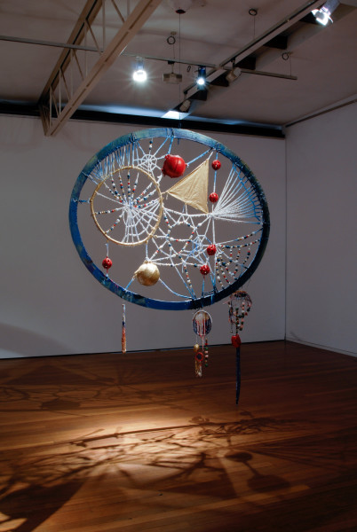 Rohan Wealleans Blood Crystal Catcher, 2006; an intricate system of wood, string, rope, ceramic beads, fish buoys, baby rattles and paint with steel stand; 278 x 202 x 20 cm; enquire
