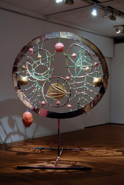 Rohan Wealleans For the Spirits of the Bust, 2006; an intricate system of wood, string, rope, ceramic beads, fish buoys, baby rattles and paint with steel stand; 300 x 155 x 28 cm; enquire