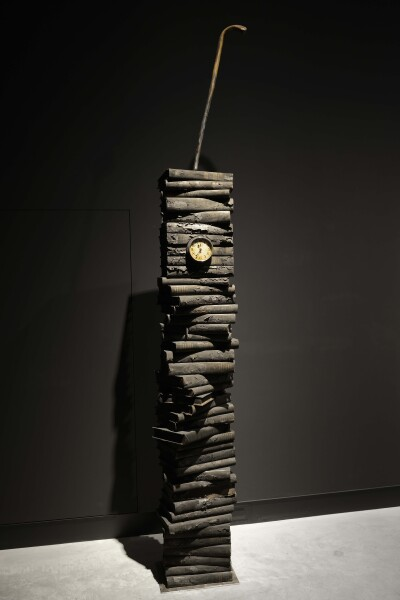 Fiona Hall Ashes to ashes, 2014; burned volumes of The Catalogue of Books in the British Library 1960-1961, clock, walking stick; 140 x 20 x 5 cm; enquire