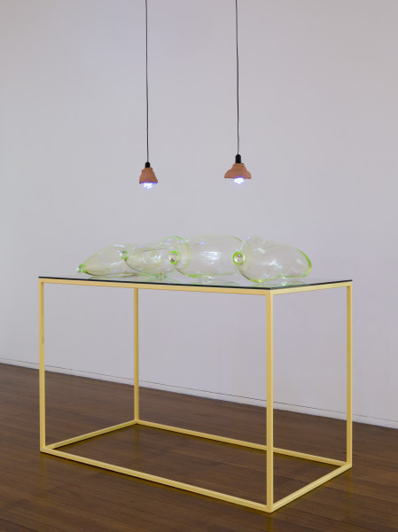 Mikala Dwyer Earthlings, 2015; Uranium glass, glass, ceramic, blacklight, holy water, mercury sol (homeopathic), brimstone (sulfur), salt (pink lake); 125 x 170 x 90 cm; enquire