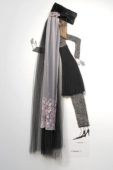 Jacqueline Fraser   , 2004; Nylon hair, faux fur, black tulle, French hand beaded lace, Italian wool suiting, vylene stiffening, pleated plyester; 170 x 100 x 15 cm; enquire