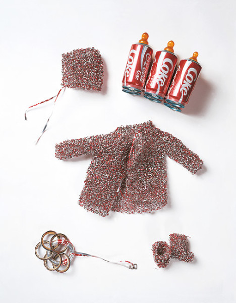 Fiona Hall Medicine Bundles for the non-born child, 1993; aluminium, rubber teats; child's jacket (28 x 44 x 10 cm), child's booties each (8.5 x 9 x 5.2 cm), child's bonnet (13 x 13 x 7 cm), child's teething ring (31 x 9 cm) diameter; enquire