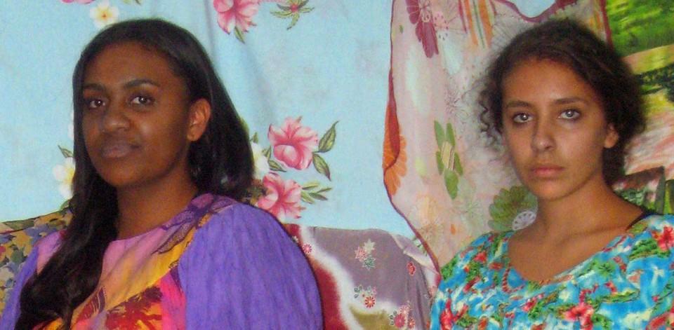 Destiny Deacon Two young Islander women from Melbourne, 2011; colour inkjet print; 20.9 x 42.7 cm (image size); Edition of 5 + 2 APs; enquire