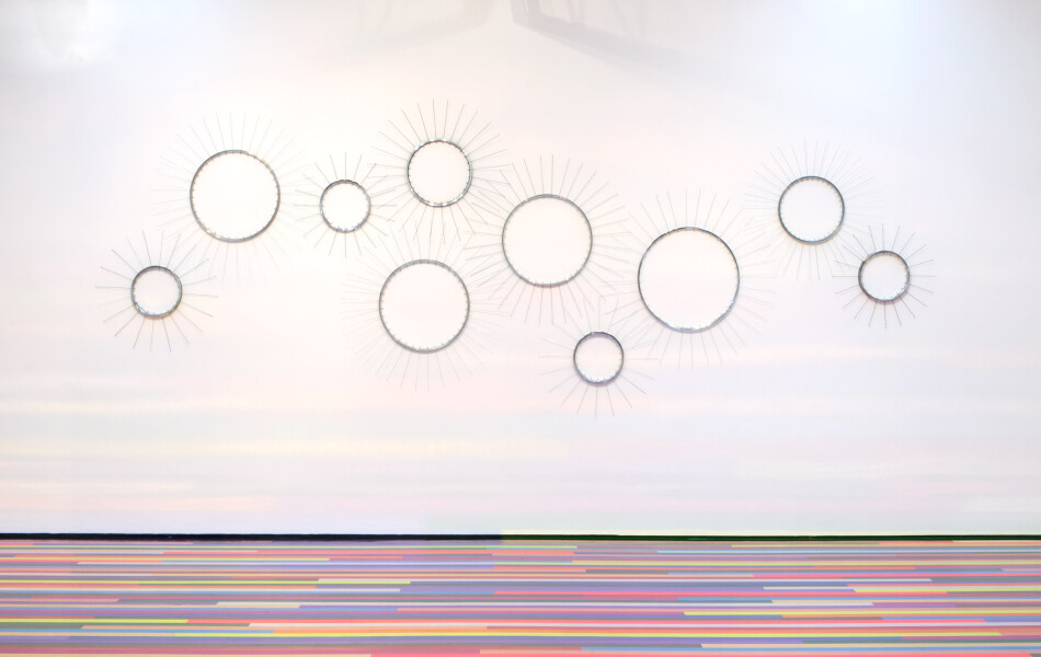 Jim Lambie Here Comes the Sun, 2015; Aluminium bicycle wheels; dimensions variable (installed dimensions 290 x 550cm); enquire