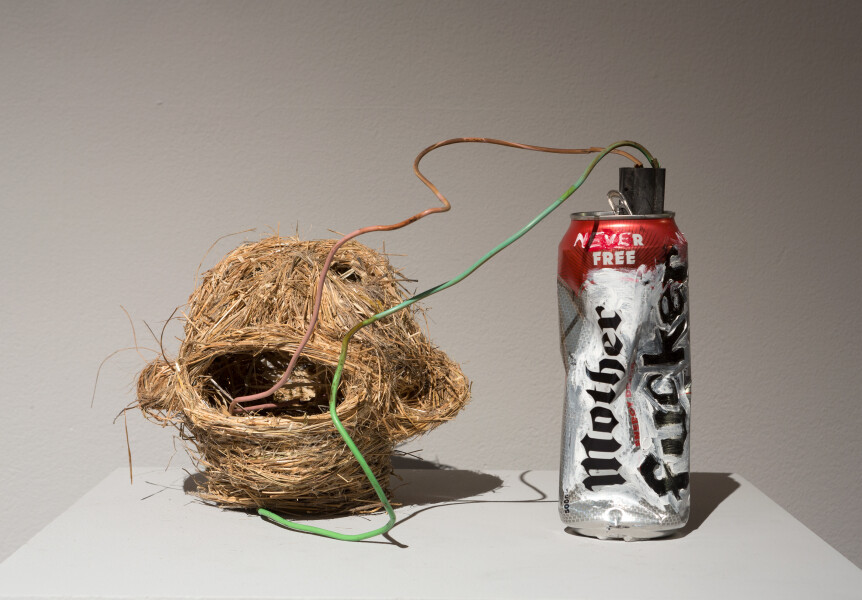 Fiona Hall Mother Fucker (improvised explosive device), 2017; tjanpi grass, aluminium can, wire, paint; variable; enquire