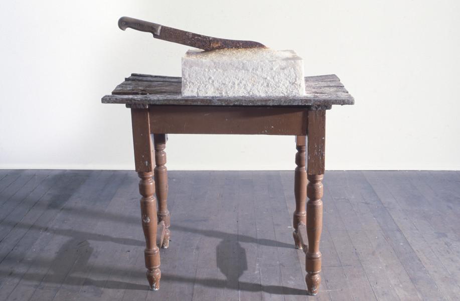 Simone Mangos ..permeating....confluence, 1986; machete, salt, table; 84 x 101 x 46 cm; enquire