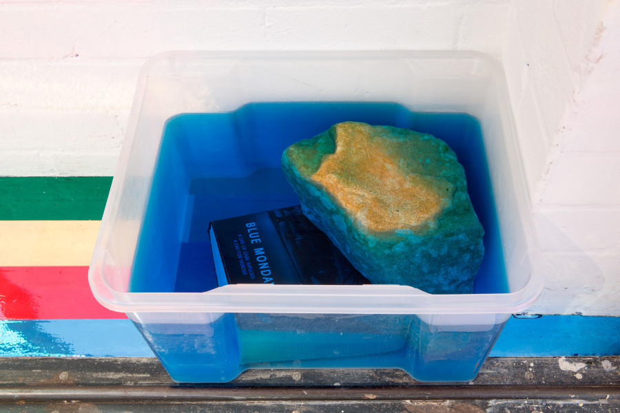 Jim Lambie Blue Monday, 2015; colour dyed water, book, stone, plastic box; 26 x 45 x 36 cm; enquire
