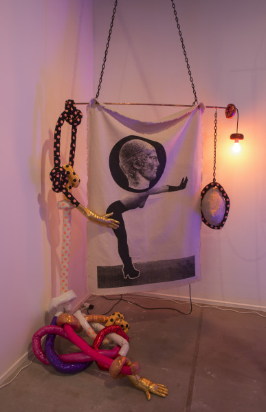 Sarah  Contos Push, 2014; Screenprint on cotton, copper, plastic chain, metal hooks, wood, light fixture, light globe, various fabrics, poly fil and found gloves; Enquire