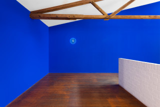 installation view; Tom Polo clockwatch (for Roslyn Oxley9), 2021; created with Dara Gill; wall painting and digital video; dimensions variable; 8 hours 15 mins; enquire
