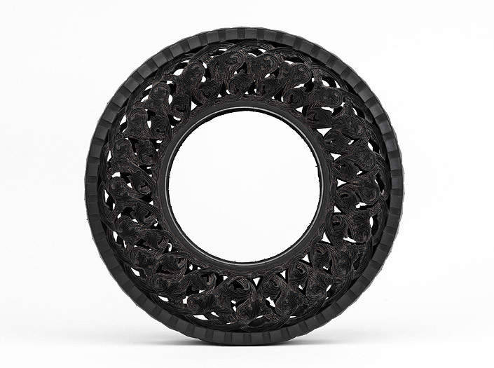 Wim Delvoye Untitled (Car Tyre) 4, 0; handcarved car tyre; 81.5 x 81.5 x 17 cm; enquire