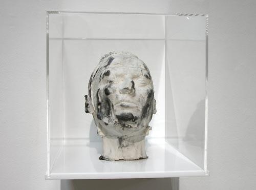 Julie Rrap Eraser Head 2, 2006; silicon rubber, silica flour and graphite mounted in Perspex box; sculpture: 21 x 15 x 25 cm; box: 30 x 30 x 40 cm; enquire