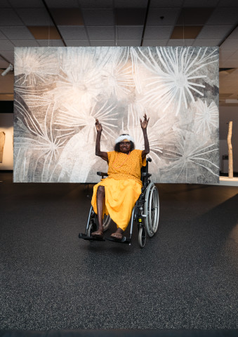 Nyapanyapa Yunupingu at her solo exhibition 'the moment eternal: Nyapanyapa Yunupingu' at the MAGNT