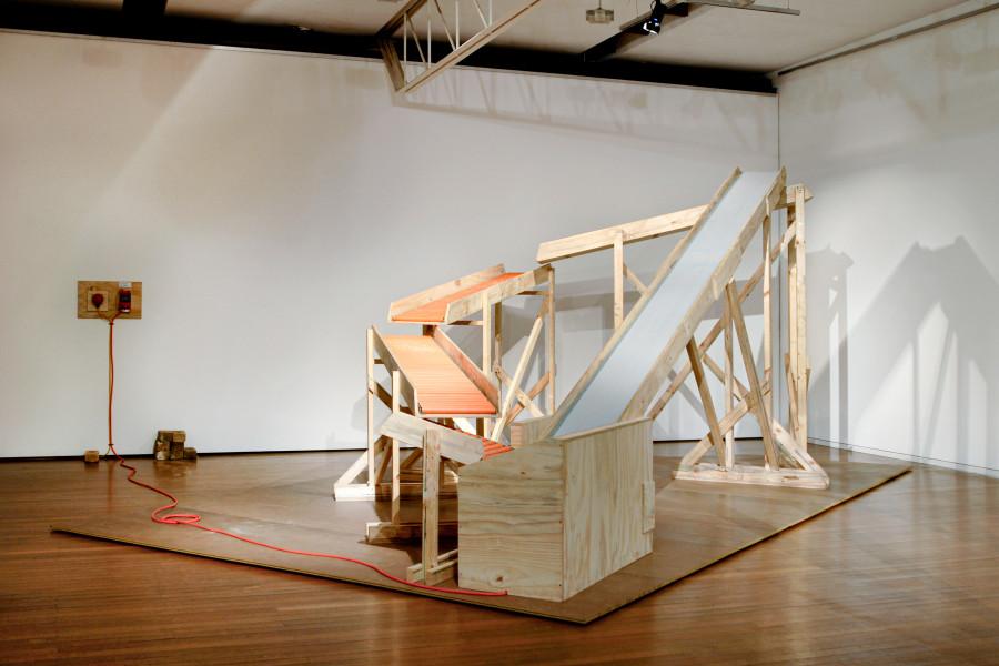 Marley Dawson Big one liner, 2008; timber, conveyor belt, plastic rollers, electrics, brick; 250 x 570 x 290 cm; enquire