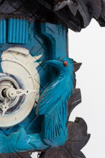 Fiona Hall Tweet (detail), 2014; from the series Wrong Way Time; painted cuckoo clock; 30 x 25 x 15 cm; enquire