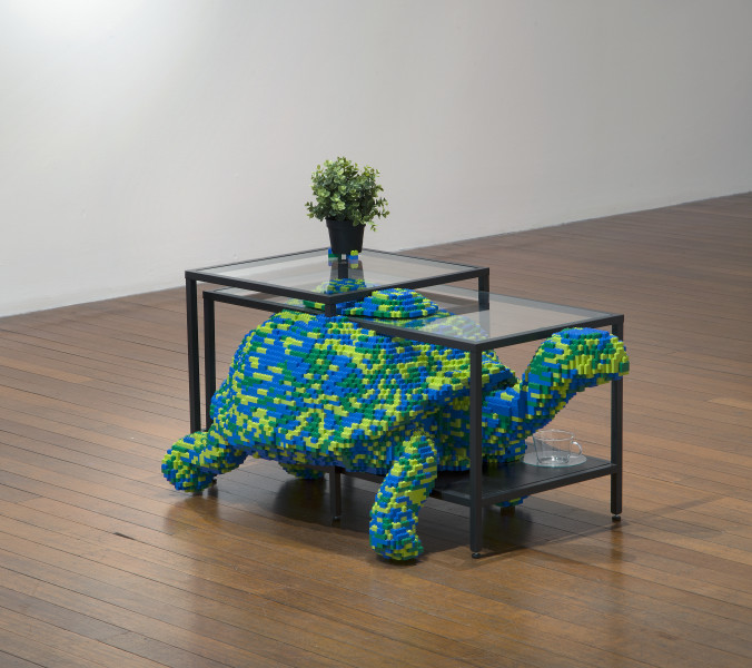 Claire Healy and Sean Cordeiro Upstairs Living Room – Tortoise, 2014; Lego, Ikea coffee table and plant; 75 x 109 x 62 cm; enquire