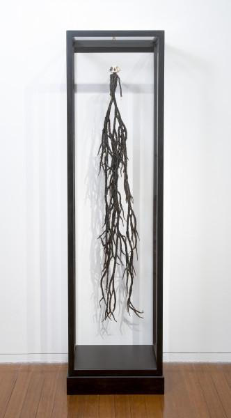 Fiona Hall Monkey Magic, 2012; glass beads, wire, monkey skull, dice, vitrine; 148 x 32 x 17 cm; enquire