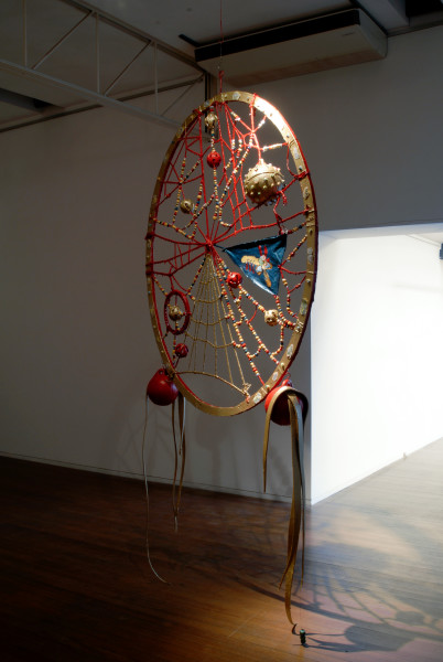 Rohan Wealleans Red Spirit Snare, 2006; an intricate system of wood, string, rope, ceramic beads, fish buoys, baby rattles and paint with steel stand; 294 x 226.5 x 280 cm; enquire