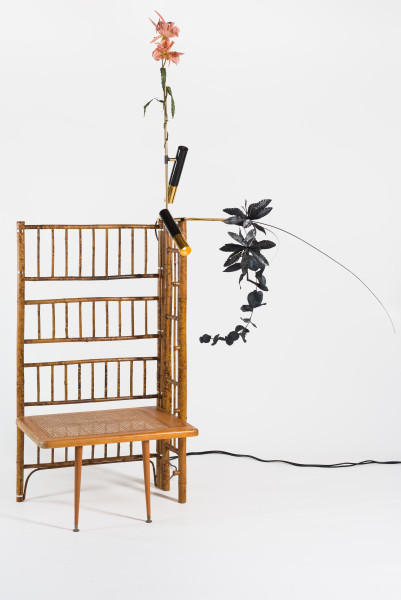 Sarah  Contos Dressing room, 2019; repurposed cane, light fixtures, fake flowers; 220 x 185 x 77 cm; enquire