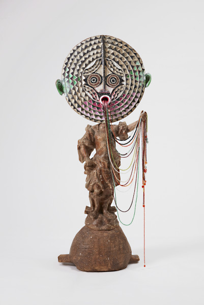 Del Kathryn Barton salad bowl #5, 2016; faceted gemstones, 19th century carved female figure dressed in classical Roman garb, 1940 carved fruit bowl, sun mask Burkina Faso, acrylic paint; 210 x 50 x 50 cm; (with plinth); enquire