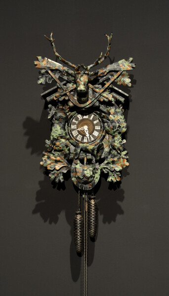 Fiona Hall Untitled, 2015; from the series Wrong Way Time; Painted cuckoo clock; 86 x 44 x 17 cm; (not including chimes); enquire