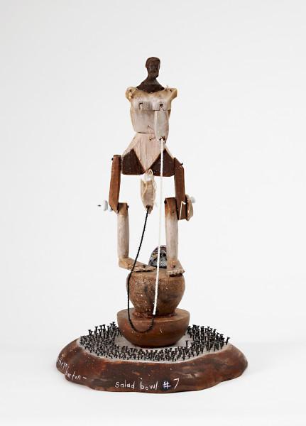 Del Kathryn Barton salad bowl #7, 2016; vintage wooden priest head, vintage wooden puppet body, wooden lazy susan salad bowl, vintage holy water ladle, nails, acrylic paint; 65 x 38 x 38 cm; (with plinth); enquire