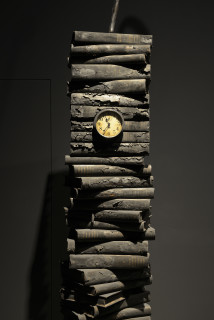 Fiona Hall Ashes to ashes (detail), 2014; burned volumes of The Catalogue of Books in the British Library 1960-1961, clock, walking stick; 140 x 20 x 5 cm; enquire