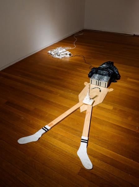 Matthew Hopkins Self Portrait as a Guilty Catholic Brain 2, 2008; plywood, timber, speakers, stereo, cd, socks, powerboards, plasticine, plastic eyes, plastic bag; figure; 220 x 100 cm; enquire