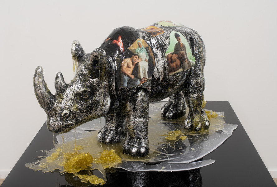 Dale Frank Beautiful Muslim Muscles, 2018; Muslim muscles and mothers paper images on Rhino with Epoxyglass and gold glitter on black base; 59 x 100 x 100 cm; enquire