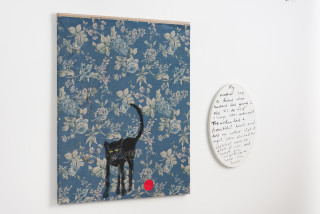 installation view; Jenny Watson Old black cat and red rubber ball, 2018; acrylic on rabbit skin glue primed Japanese chintz and acrylic on oval text panel; two parts: 100 x 84 cm; 51 x 36 cm; enquire