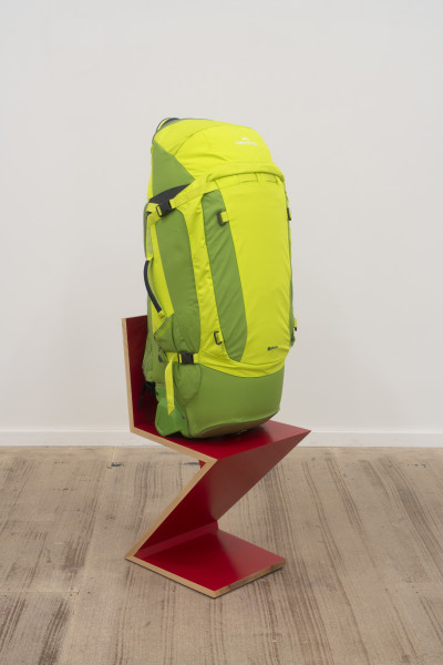 Dale Frank Greek Museums, 2018; compression filled Kathmandu wheeled luggage Duffle bag backpack on Zig Zag Gerrit Rietveld chair; 130 x 40 x 48 cm; Enquire