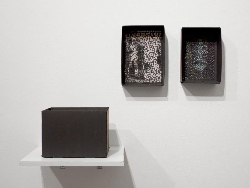 Daniel Boyd Up in Smoke Tour 2a and 2b, 2012; oil and archival glue on photocopy in Natural History Museum skull box; 3 objects, installed dimensions variable; enquire