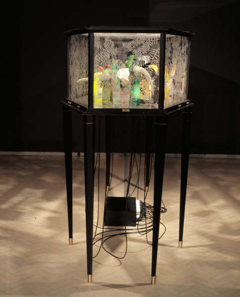 Fiona Hall Mourning Chorus, 2007-08; resin, plastic bottles, lights, vinyl in vitrine; 157 x 217 x 88 cm; Edition of 5 + AP 1; enquire