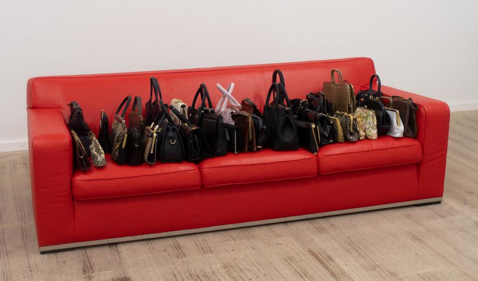 Dale Frank The Crimea - Amanda, 2018; ladies handbags on painted cotton Poltrona Frau sofa; 67 x 206 x 90 cm; enquire