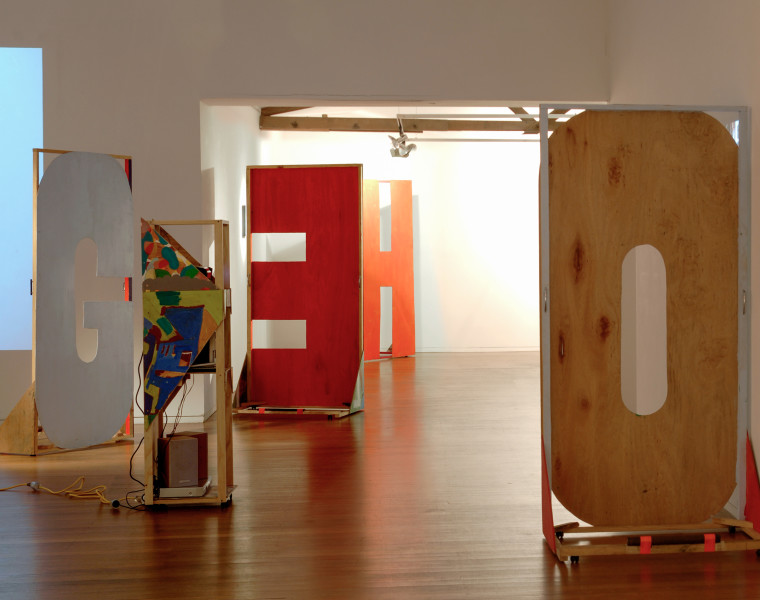 Agatha Gothe-Snape Enough and other organisations, 2007; from the series (detail); acrylic on ply, sawn paintings, timber, steel weights, casters, handles; 6 objects, each 240 x 100 x 65 cm; enquire