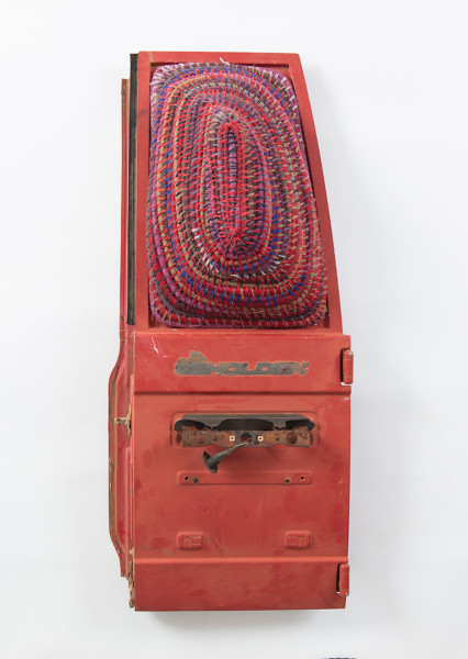 Claire Healy and Sean Cordeiro Someone did a burnout on the aristrip, 2017; wool, MInari desert grass and car doors; 106 x 46 x 26 cm; enquire