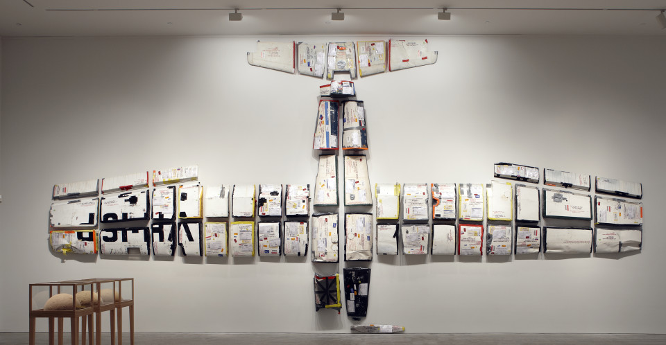 Claire Healy and Sean Cordeiro Par Avion, 2011; 70 cut pieces from a Cessna 172 airplane, gaffa tape, postage paraphenalia; 530 x 1160 cm overall installed; enquire