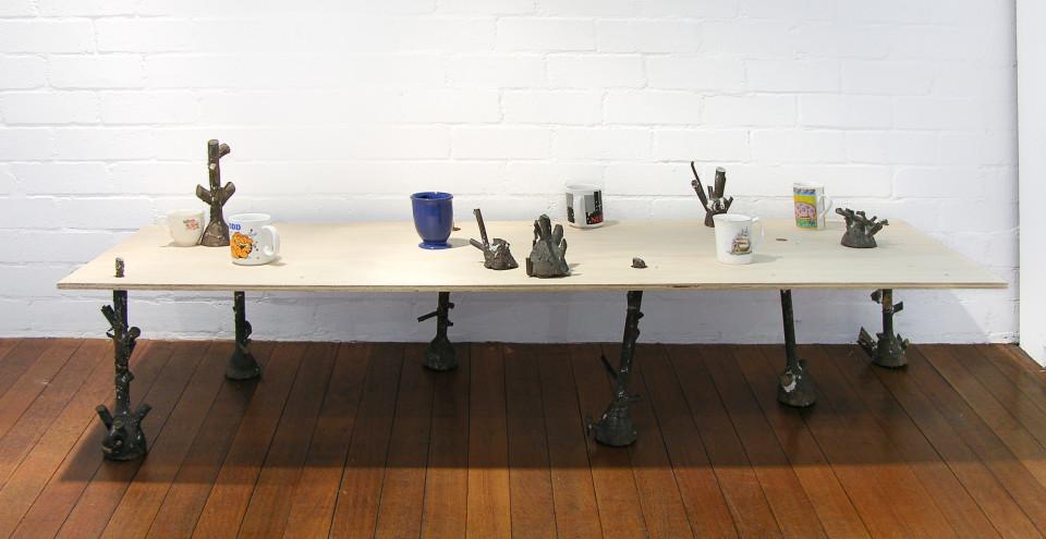 Christopher Hanrahan Conversation Piece, 2006; bronze, plywood and ceramic mugs; 33.5 x 180 x 60 cm; enquire